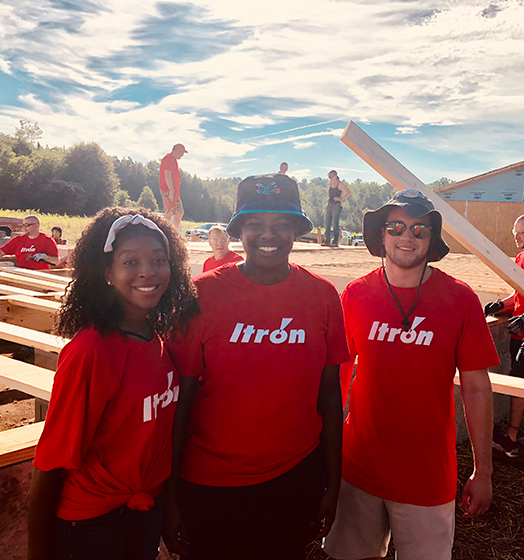 itron-employees-volunteering-building-a-house