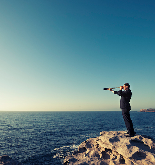 Man looking through telescope