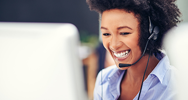 women smiling with headset on